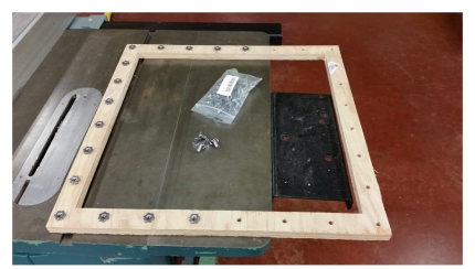 Insertion of T - nuts Into Upper Hinged Frame Assembly